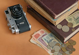 Old soviet film camera and money poster