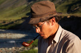 man in hat is smoking tobacco-pipe poster