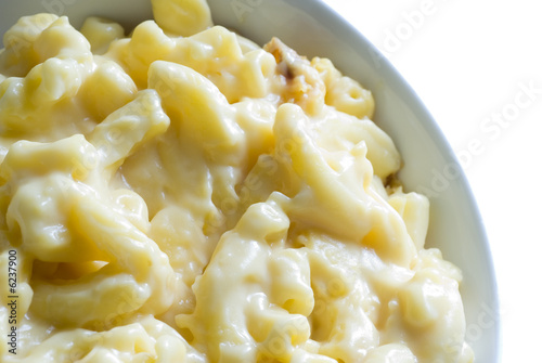macaroni and cheese macro in bowl with white background
