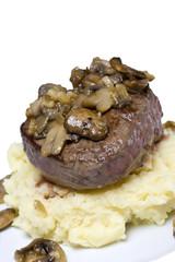 Filet staek on mashed potatoes with mushroom and onion sauce