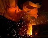 A tradesman welding steel poster