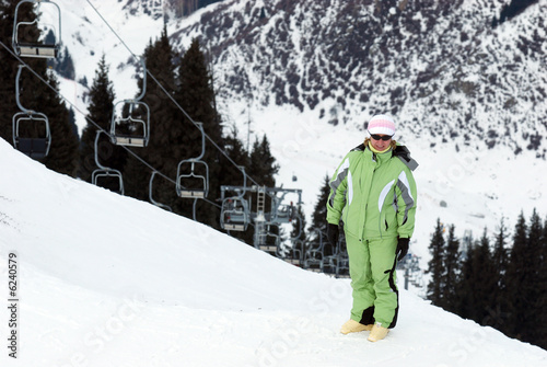 Woman on mountain ski resort slope