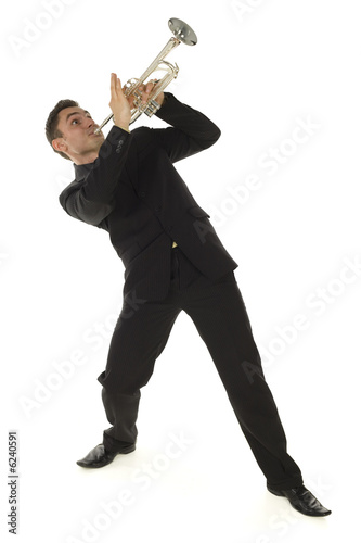 Man in suit standing and trumpet melody. Whole body