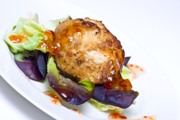 Fresh crab cake salad with sweet chili sauce