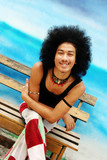 Happy young Thai man with an afro. poster