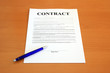 Contract document with blue pen (fictitious legal text)