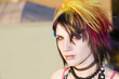 Close-up of a colorful young punk woman
