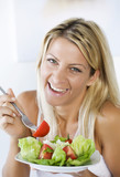 high-key portrait smiling female eating her salad