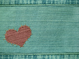 Background - the heart attached by threads to jeans poster