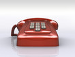 Red phone over white floor. Antique way of communication.