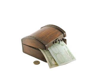 Money and an old chest, isolated on white