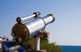 Tourist telescope at sea coast. poster