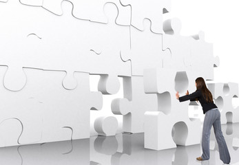 business woman making a puzzle over a white background