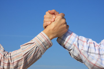 Partner and Friendship: two young man shaking hand