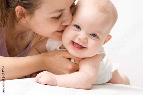 Mother's love. Cute baby 6 month with mother.