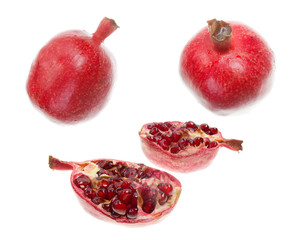 cut pomegranate with seeds around in white background
