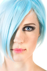 Close-up portrait of a girl with blue hair