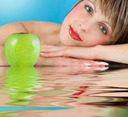 Woman  with juicy green apple