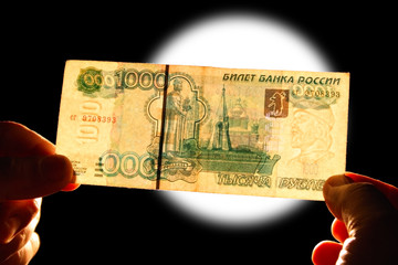 checking watermark 1000 russian rubles over white lamp