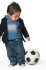hispanic boy with soccer ball