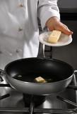 Chef preparing food on professional kitchen in restaurant poster