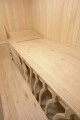 wooden bench of steam room in sauna