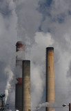 smoke stacks billowing pollution and smoke into the air poster