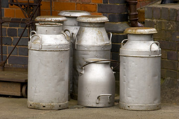 Milk churns waiting for collection on the station platform