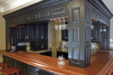 Custom-built bar and wood cabinetry poster