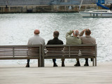 group of sitting men of pensioners poster