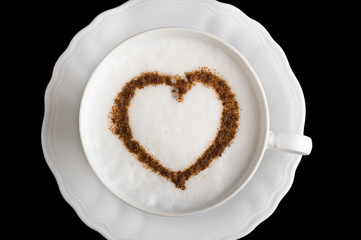Coffee cappuccino cup with cinnamon heart shape