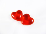 Two red three-dimensional hearts isolated on white background poster