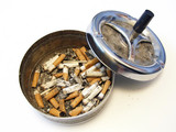 metallic ash tray with cover and on half full of .stumps poster