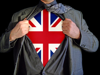 A business man opens his shirt to reveal a british flag