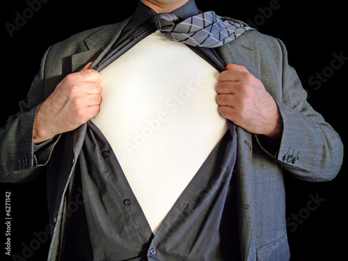 A business man tearing open his shirt to reveal a blank t shirt