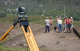 Working on archeological site with theodolite poster