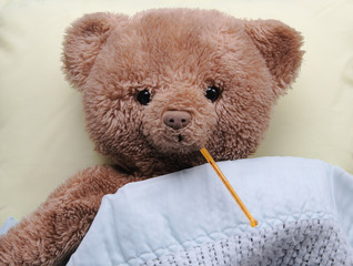 sick teddy with thermometer