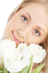 picture of happy blond with white tulips