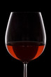 Isolated red wine glass over a black background