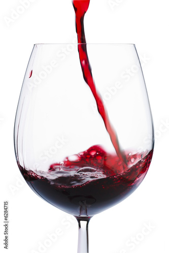 Badly poured red wine in the glass