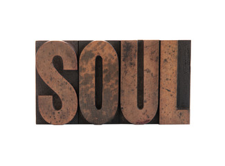 the word 'soul' in old, ink-stained wood letters