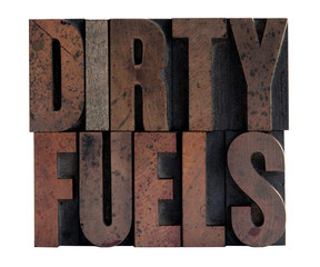the phrase 'dirty fuels' in ink-stained letterpress wood type