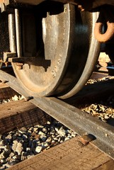 A close up of a wheel on the train tracks.