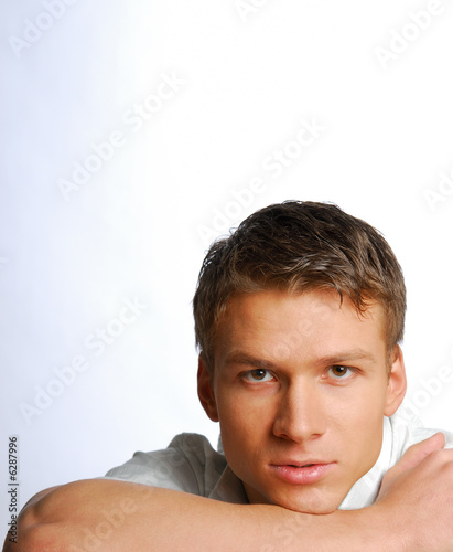 Pretty young man looking at camera. Face is close-up