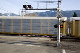 Railroad Crossing gate with blurred train in  motion behind