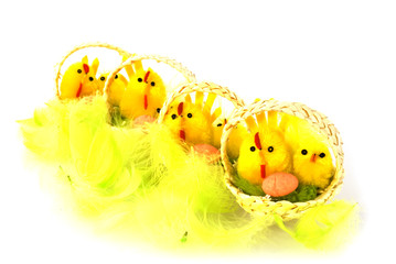 Yellow easter baskets with chicks and yellow feathers