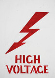 A roughly painted High Voltage sign
