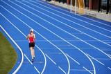 runner on blue track poster