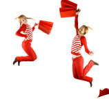happy teenager girls  with red bags  jumping - over white