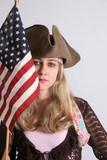 Woman in try cornered hat and US flag